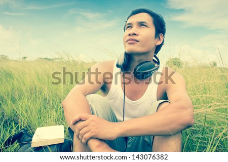 Man Listening To Music Series,Feel The Nature,Dramatic Look - stock photo