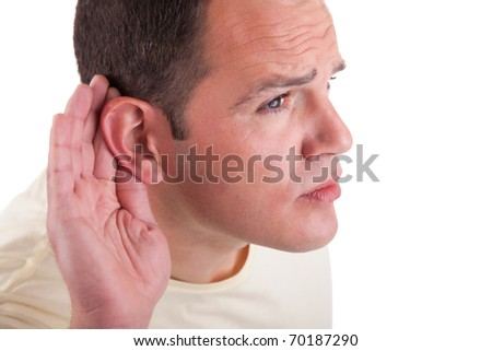 man, listening, viewing the  gesture of hand behind the ear, isolated on white background - stock photo