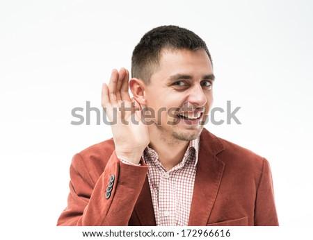 Man listens. Hand near ear. - stock photo