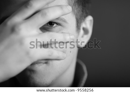 Man look by one eye - stock photo