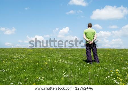 man look on horizon of field - stock photo