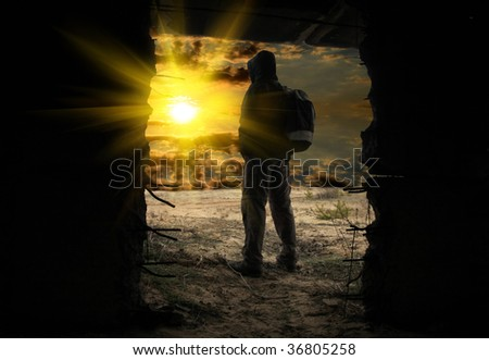 man look on sunset in aperture abandoned bunker
