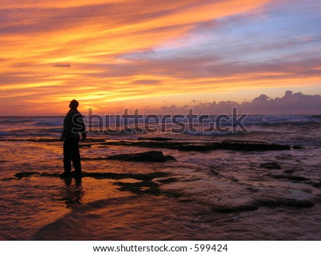 Man looking amazed on sunset sky