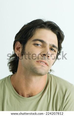 Man looking at camera, portrait - stock photo