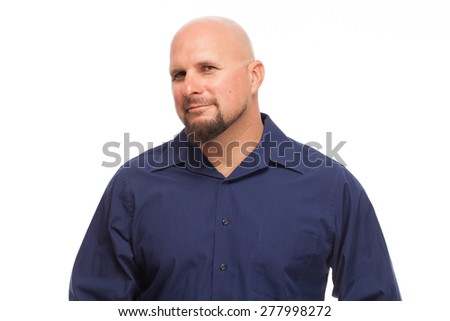 Man looking at camera with a nice grin. Portrait of bald, handsome young man isolated on white background.  - stock photo