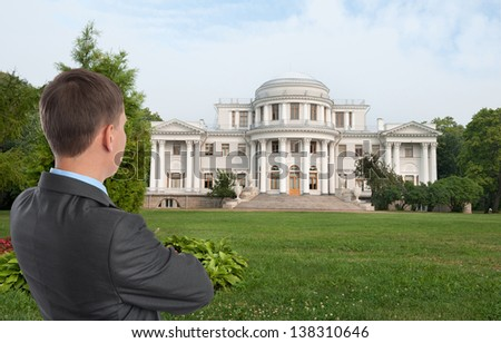 man looking at his dream house - stock photo