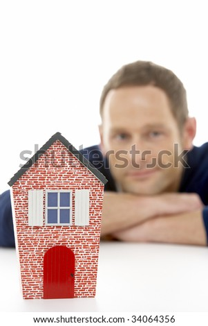 Man Looking At Model House - stock photo
