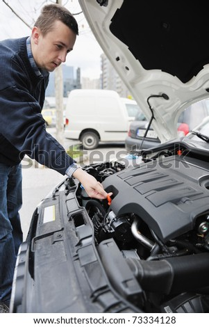 man looking at new car vihicle engine and try to find probelm at repair fix and maintanance service - stock photo