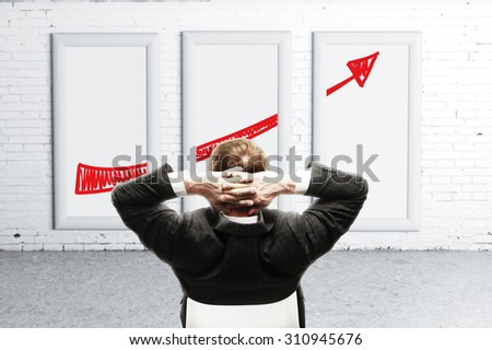 man looking at placard with business concept - stock photo