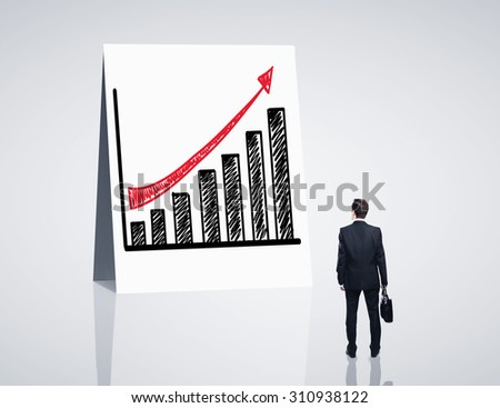 man looking at poster with growth chart - stock photo