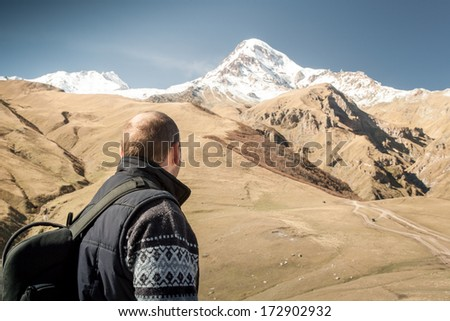 Man looking at the mountain