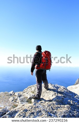 man looking at the mountains - stock photo