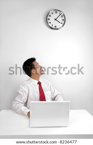Man looking at the time in office