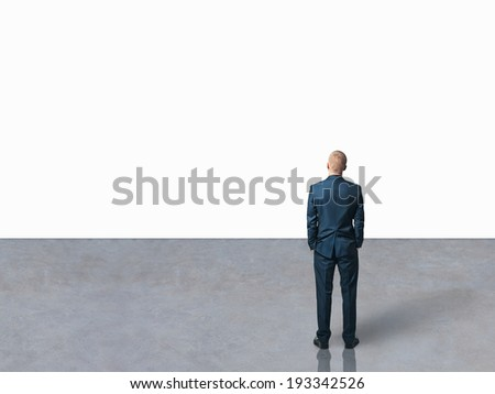 man looking at the white blank wall - stock photo