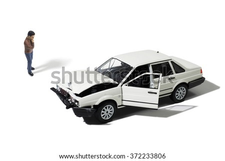 Man Looking at Wrecked Automobile (Model) - stock photo