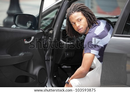 Man looking behind his car