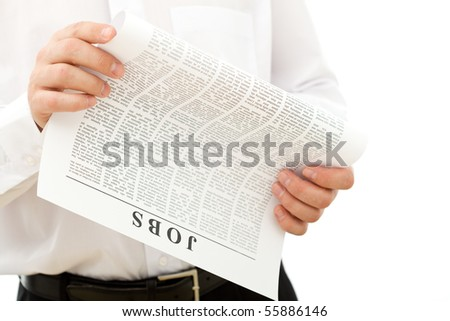 Man looking for job reading ads - isolated closeup - stock photo