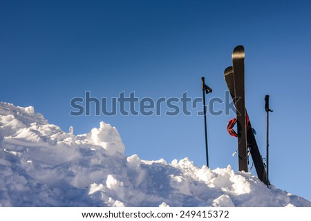 Man looking into the distance on top of a mountain in the Alps - stock photo