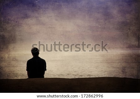 Man looking out over the Pacific ocean - stock photo