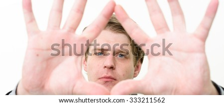 Man looking through his hands