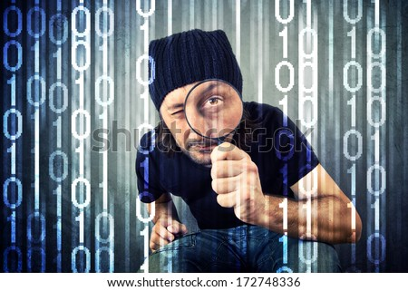 Man looking through magnifying glass and inspecting binary code. Heartbleed bug concept, - stock photo