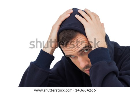 Man looking troubled on white background - stock photo