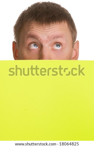 Man looking up over a yellow card isolated on white background