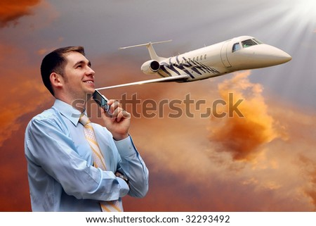 man looks at airplane in air with sunrise sky - stock photo