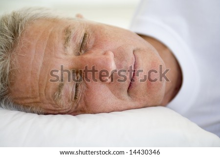 Man lying in bed sleeping - stock photo
