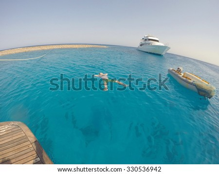Man lying on the surface of the sea