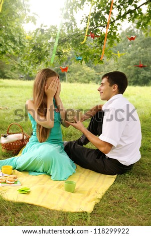 Man made a surprise for a woman - stock photo