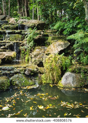 Man made garden to imitate the waterfall in restaurant, Rayong Thailand - stock photo
