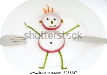 Man made out of vegetables on a dish. - stock photo