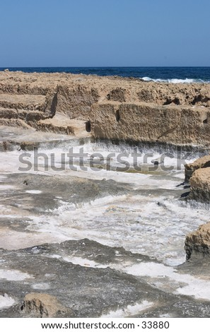 Man-made salt-pans at Stavros, Akrotiri, Crete. Such pans have been used in salt-making at least since Roman times and perhaps from Minoan. - stock photo