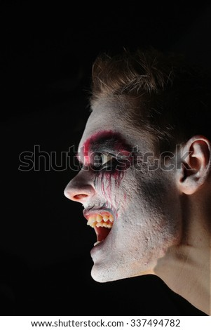Man makeup Halloween Scary emotions face demon - stock photo