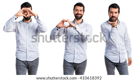 Man making a heart with his hands - stock photo