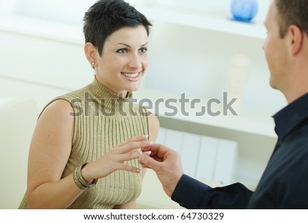Man making a proposal giving engagement ring to her fiencee.?