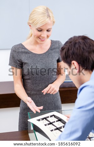 Man making choice of engagement ring at jeweler's shop. Concept of wealth and luxurious life - stock photo