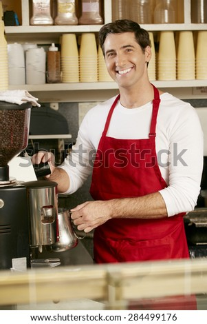 Man Making Coffee In Shop