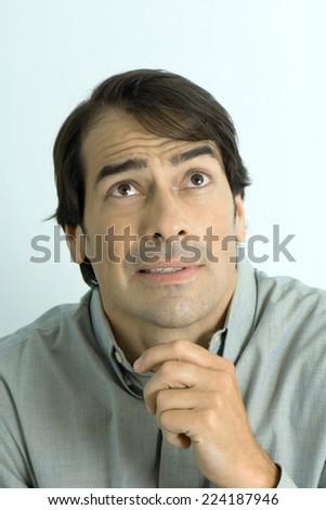 Man making face, portrait - stock photo