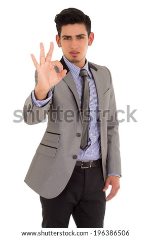 man making ok sign in fashionable suit on white background