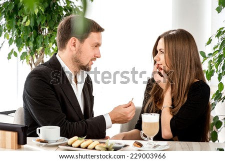 Man making proposal with the ring to his girlfriend at the restaurant. Shocked and surprised woman - stock photo