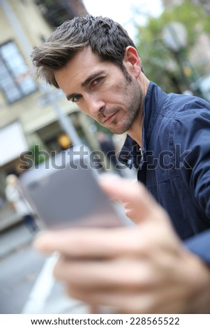 Man making selfy with smartphone in street of New York