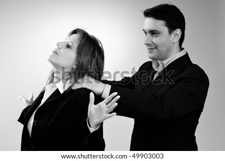 man massaging his manager - stock photo