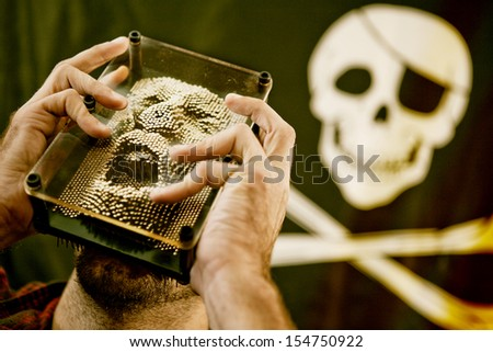 Man moulding a yelling face filled with anger with skull in background - stock photo