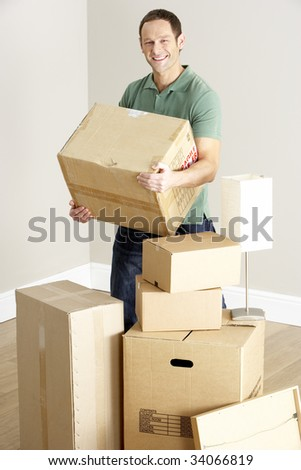 Man Moving Into New Home - stock photo