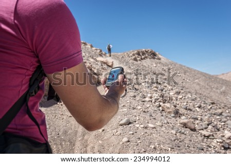 Man navigates with a gps in the hand - stock photo