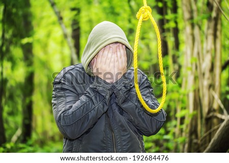 Man near noose in the  woods - stock photo
