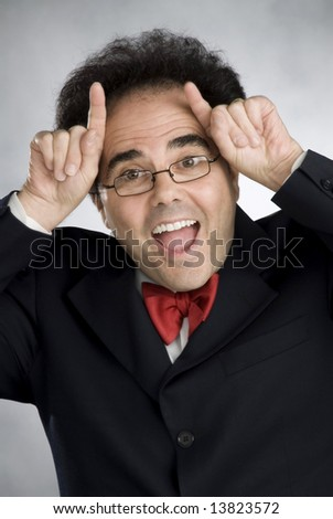 man of many expressions, wearing a suit jacket and red bowtie, sometimes wearing glasses