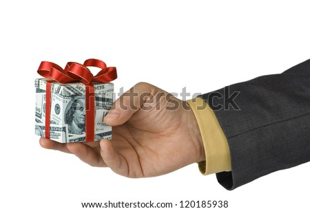 Man offering an expensive gift box wrapped in us dollar bills